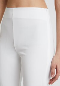 Club L London - GIRL BOSS TROUSERS - Leggings - white - 4