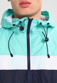 Urban Classics - HOODED COLLEGE WINDBREAKER - Summer jacket - navy/mint/white - 3