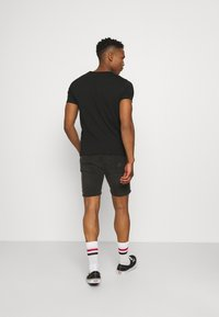Calvin Klein Jeans - MICRO BRANDING ESSENTIAL TEE - T-shirt basic - black - 2