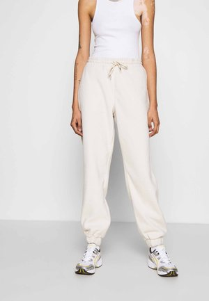 FANNY TROUSERS - Tracksuit bottoms - beige