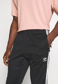 adidas Originals - UNISEX - Trainingsbroek - black/white - 3