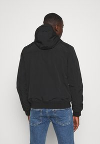 Tommy Jeans - PADDED JACKET - Light jacket - black - 2