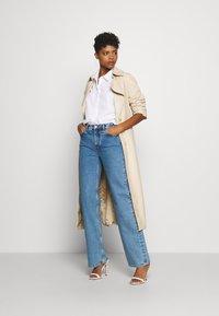 Vero Moda - VMMIE SHIRT  - Button-down blouse - bright white - 1