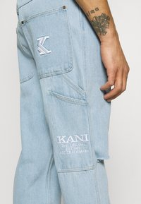 Karl Kani - RINSE PANTS - Relaxed fit jeans - light blue - 4