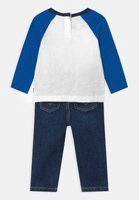 Levi's® - RAGLANSET - Straight leg jeans - blue/white - 1