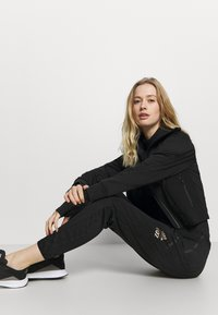 adidas Performance - SPORTS TRACK - Training jacket - black - 4
