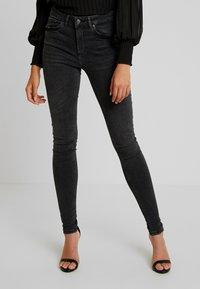 Vero Moda - VMLUX SUPER SLIM - Jeans Skinny Fit - black - 0