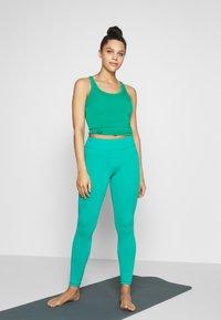 Curare Yogawear - RACERBACK  - Top - green lagoon - 1