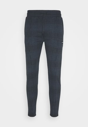 CHECK PANTS WITH RAISED RUBBER BADGE - Tracksuit bottoms - blue