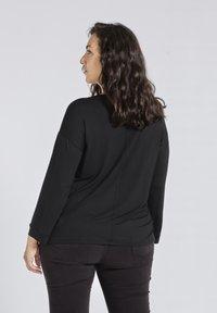 SPG Woman - Longsleeve - black - 2