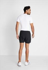 Craft - ADV ESSENCE STRETCH SHORTS - Sports shorts - black - 2