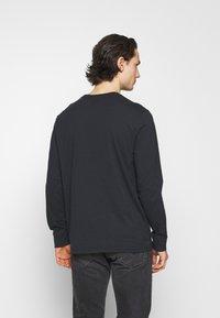 Levi's® - GRAPHIC TEE UNISEX - Long sleeved top - blacks - 2
