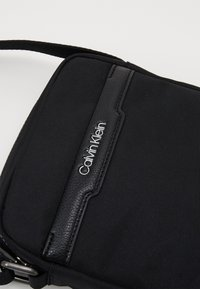Calvin Klein - REPORTER - Across body bag - black
