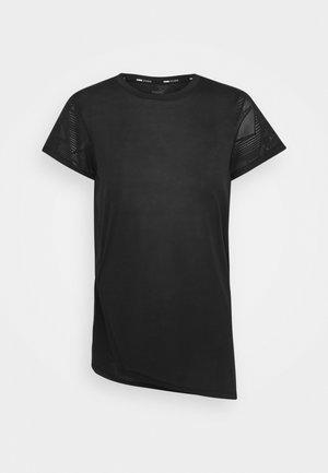 STUDIO TEE - Print T-shirt - puma black