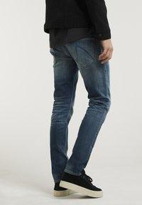 CHASIN' - CROWN ELI - Slim fit jeans - blue denim - 1