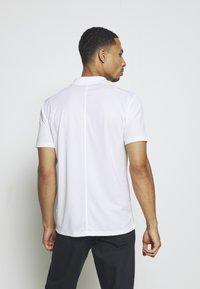 Nike Performance - DRY VICTORY SOLID SLIM - Sports shirt - white/black - 2