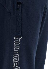 Hummel - OCHO UNISEX - Tracksuit bottoms - black iris - 4