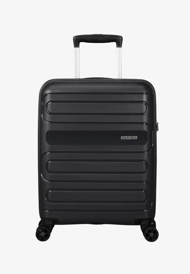 SUNSIDE - Wheeled suitcase - black