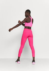 Ellesse - CANA - Tracksuit bottoms - neon pink - 2