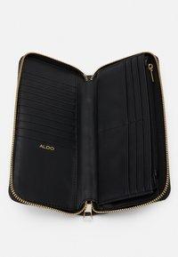 ALDO - GIMA - Lommebok - black/gold-coloured - 2