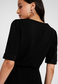 NA-KD - WRAP PUFF SLEEVE MINI DRESS - Day dress - deep black - 6