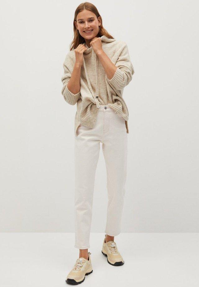 NEWMOM - Slim fit jeans - ecru