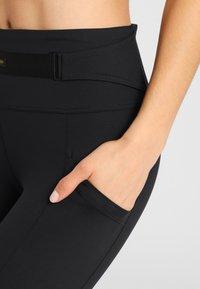 Daquïni - MOTO - Leggings - Trousers - black - 4