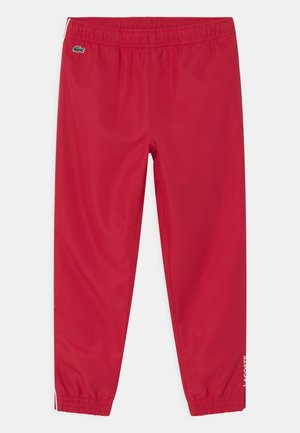 TENNIS UNISEX - Tracksuit bottoms - ruby/white