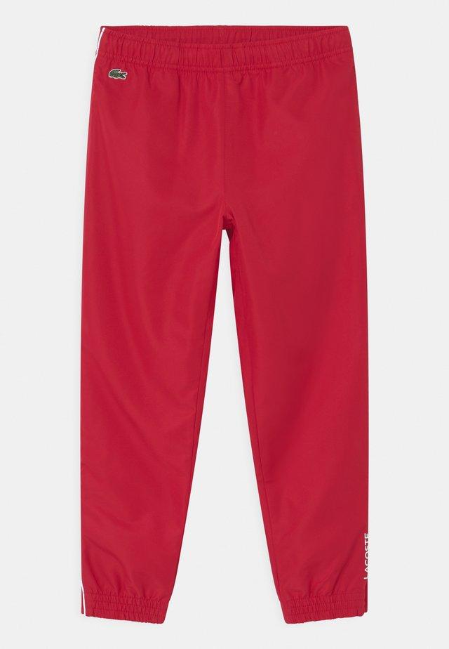 TENNIS UNISEX - Pantalon de survêtement - ruby/white