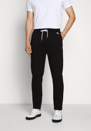 PANTS - Jogginghose - black