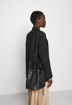 LEXI DRAWSTRING - Handbag - black