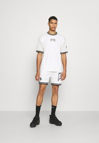 The Couture Club - VARSITY BADGED MESH DROP CROTCH SHORTS - Shorts - off white - 1