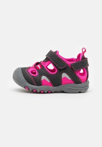 PEPPER UNISEX - Walking sandals - black/fuxia