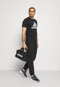adidas Performance - PANT - Träningsbyxor - black - 1