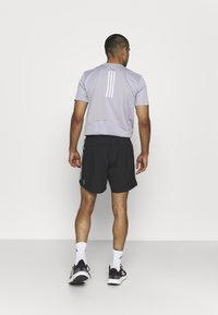 adidas Performance - OWN THE RESPONSE AEROREADY - Korte sportsbukser - black - 2