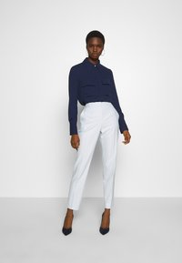 HUGO - HERILA - Trousers - light pastel blue - 1