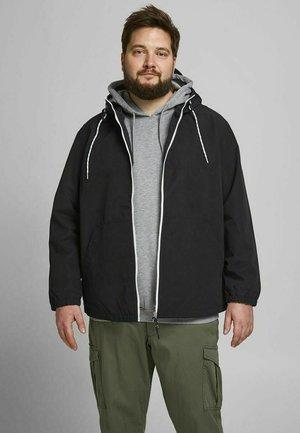 LÄSSIGE - Outdoor jacket - black