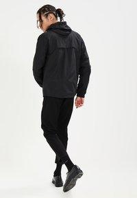 New Balance - ATHLETICS - Summer jacket - black - 2