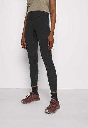 WARM - Leggings - black