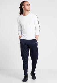JAKO - ACTIVE - Teplákové kalhoty - navy/white - 1