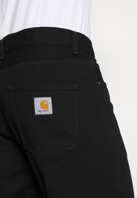 Carhartt WIP - NEWEL PANT MAITLAND - Jeans relaxed fit - black rinsed - 4