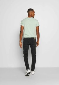 Replay - ANBASS - Slim fit jeans - black used - 2