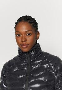 Peak Performance - HELIUM CITY LINER - Winter jacket - black - 4
