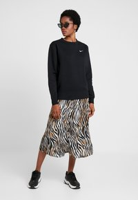 Vero Moda - VMSISSEL BUTTON SLIT SKIRT - Maxi skirt - birch - 1