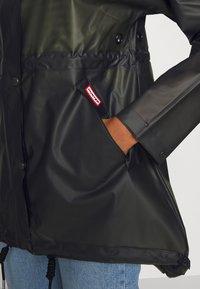 Hunter ORIGINAL - WOMENS ORIGINAL SMOCK - Waterproof jacket - dark olive - 6