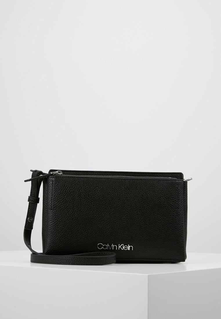 Calvin Klein - SIDED CROSSBODY - Across body bag - black