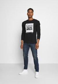 Levi's® - 502 TAPER - Jeans slim fit - dark indigo - 1
