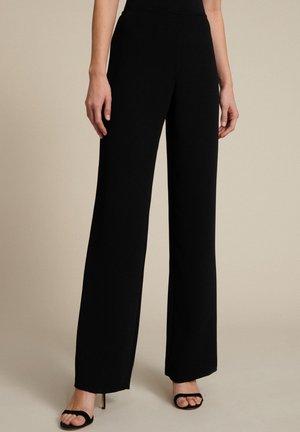 ANIS     - Trousers - nero