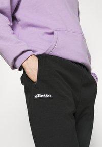 Ellesse - BERTONI TRACK PANT - Träningsbyxor - black - 4