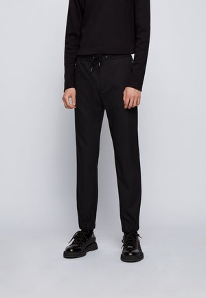 BANKS - Tracksuit bottoms - black